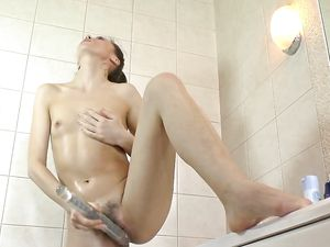 Solo Hairy Girl Pleasures Her Cunt In The Shower